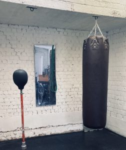 Home gym with Boxing bag by the park